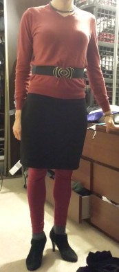 red sweater, red leggings, black skirt, black heels. The belt, with its large buckle, cinches my waist a bit more and provides another visual focal point. I should have pulled the leggings down farther to hide the socks more.